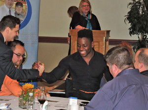 Eddie shaking hands at Rotary event